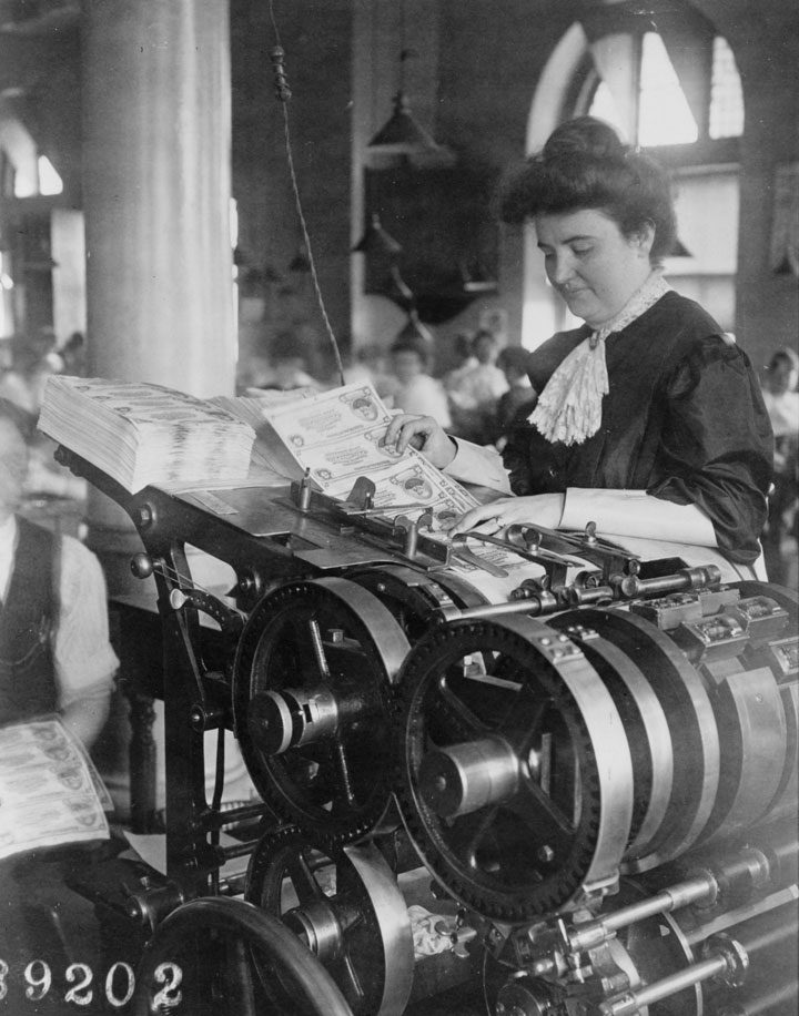 Historic image of woman printing, from the Library of Congress