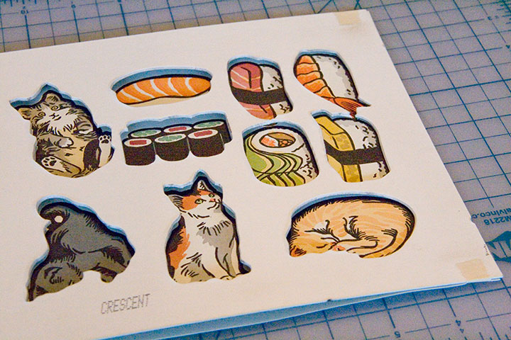 """""""Itty Bitty Kitty Committee"""" and """"Sushi"""" holiday ornaments illustrated and letterpress printed by Chandler O'Leary"""