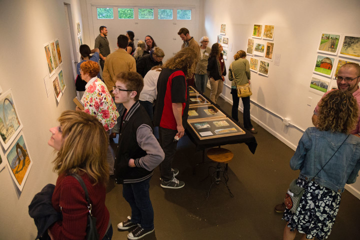 """Jaunt + Jot"" exhibition featuring sketchbook drawings by Chandler O'Leary. Photo by Shawn H. Nichols, taken at the Artist Trust on Tour: Tacoma event."