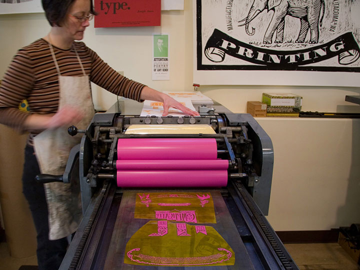 Jessica Spring printing at Springtide Press. Photo by Chandler O'Leary.