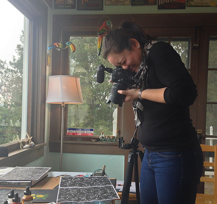Emilie Firn photographing artwork in Chandler O'Leary's studio
