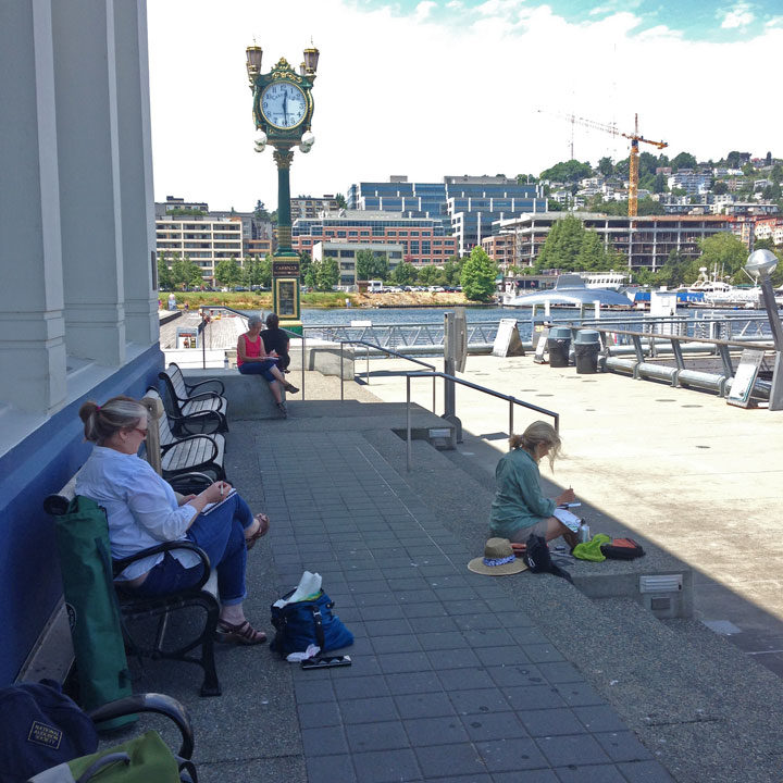 Students sketching in Seattle during urban sketching workshop with Chandler O'Leary